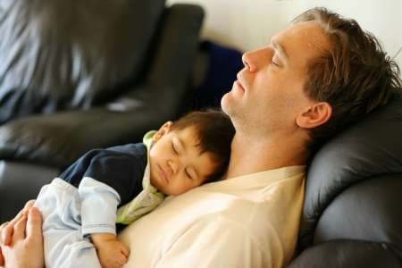 Father, baby sleeping like babies,    note : focus on father