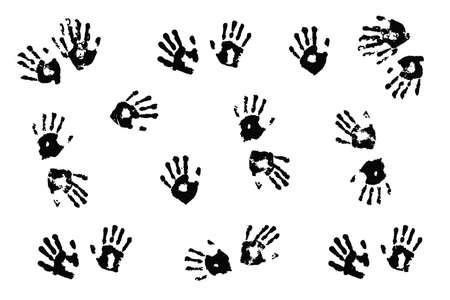 handprints: Black handprints made by children on white background. Stock Photo