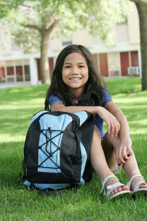 Eight year old girl ready for first day of school. Part asian,scandinavian descent.