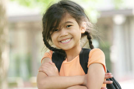Six year old girl with backpack ready for school photo