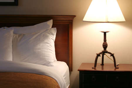 Quiet and peaceful bedside , lit by lamplight