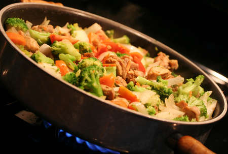 Stir fry cooking in a wok photo