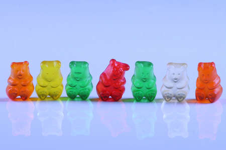 lined up: Colorful gummy bears lined up in row Stock Photo
