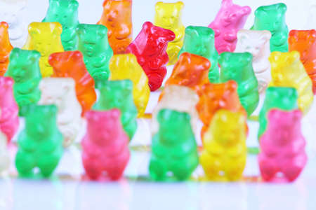 lined up: Colorful gummy bears lined up in rows Stock Photo