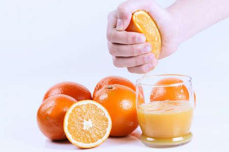preservatives: Fresh hand squeezed orange juice. Isolated on white. Stock Photo