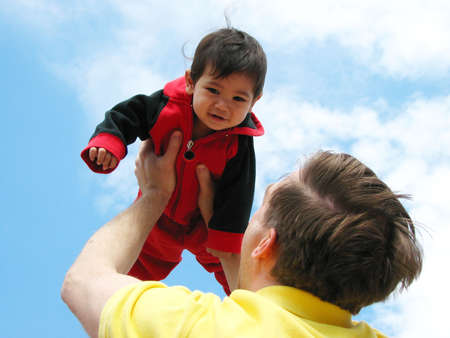 Father holding up his  boy towards the sky