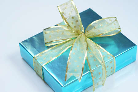Elegant blue present wrapped with golden ribbons