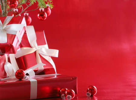 Red elegant gifts under a Christmas tree