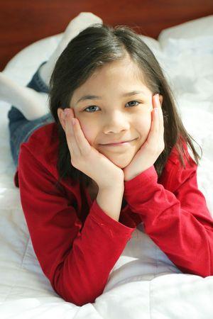 Child lying on bed thinking Stock Photo - 2591280