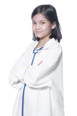 nine years old: Nine year old girl playing doctor with white lab coat and stethoscope