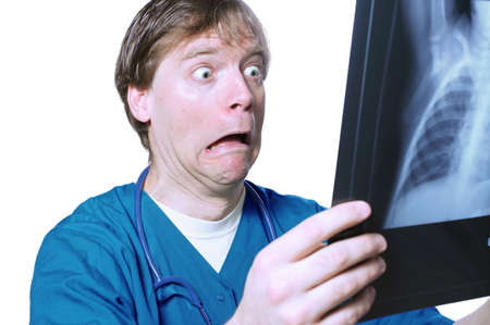 woe: Male doctor looking with humorous shock at x ray
