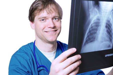 Male doctor looking at xray photo