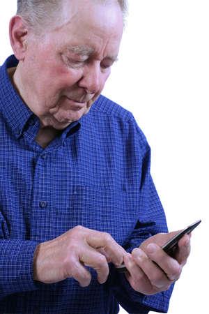 Elderly man using cell phone,dialing cell phne Stock fotó