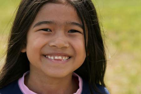 dentudo: Asia sonriente ni�a con sonrisa Toothy Foto de archivo