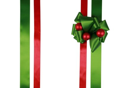 Red and green ribbons with bow, isolated, ready for overlay over a gift box