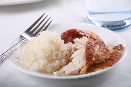 Chicken and rice meal  set on tabletop Stock Photo