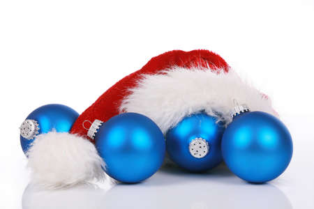 Red Santa hat with blue ornaments isolated on white