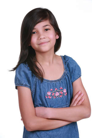 nine years old: Confident Nine year old girl  smiling with arms crossed. Part Asian-Scandinavian descent