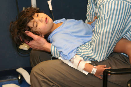 unconscious: Worn out little boy in ER