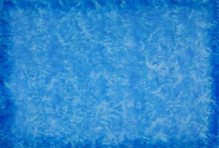 Blue mottled grunge background in variating hues