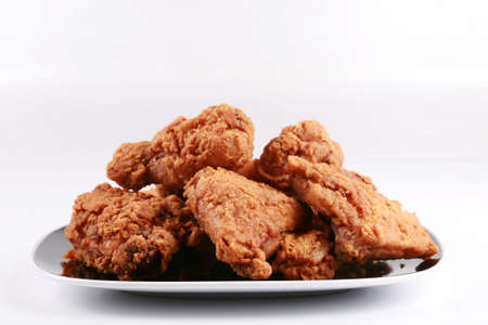 Plate of crispy, delicious fried chicken Stock Photo
