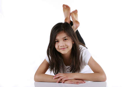 Beautiful ten year old girl happily relaxing on floor Stock Photo - 4248388
