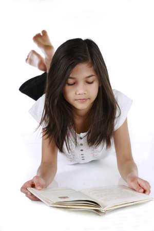 Little girl reading or studying on floor. Part Asian - Scandinavian descent