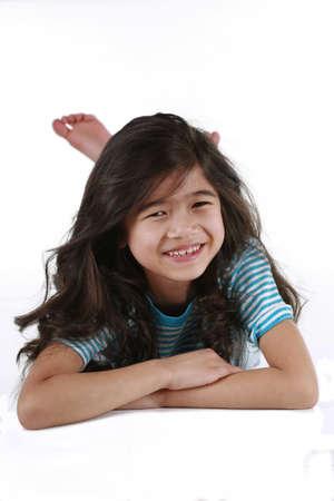 scandinavian descent: Beautiful seven year old girl lying on floor, biracial asian - scandinavian descent