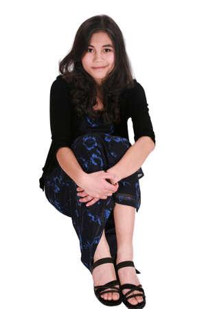 causcasian: Beautiful teen girl in elegant dress sitting relaxed