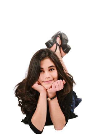 causcasian: Teen girl lying on floor chin on hand, Asian - Scandinavian descent Stock Photo