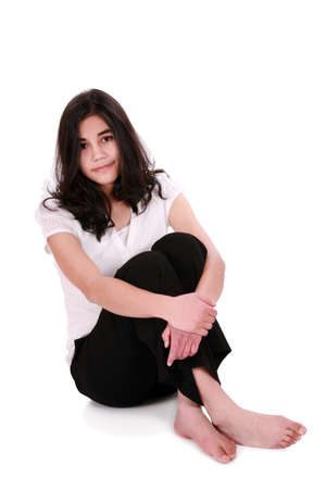 Beautiful young woman or teen relaxing on floor, part Asian - Caucasian descent Stock Photo - 4478677