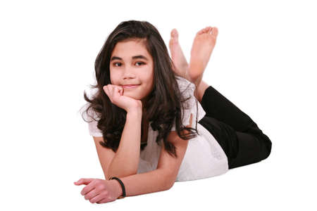 Beautiful teen girl lying on floor relaxing, part Asian- Caucasian background Stock Photo - 4478701