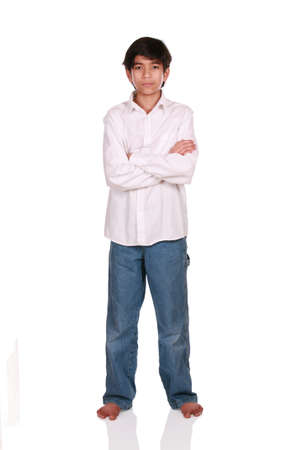 barefoot teens: Twelve year old boy standing arms crossed, part Asian - Scandinavian background Stock Photo