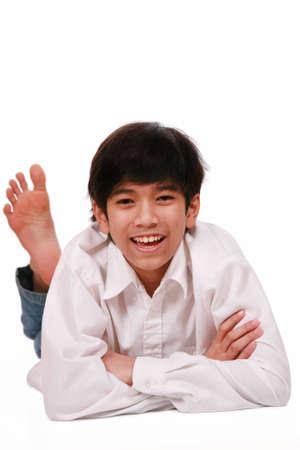 Handsome young teen boy lying on floor, part Asian- Scandinavian descent