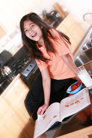 Child sitting on countertop with  glass of milk Stock Photo - 4596417
