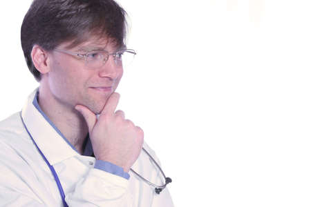 сooking: Handsome male doctor ooking off to side with hand on chin Stock Photo