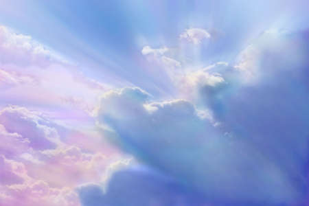 puffy: Clouds with multi colored sunlight streaming through