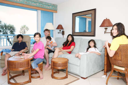 Family relaxing together in living room Stock Photo - 4942940