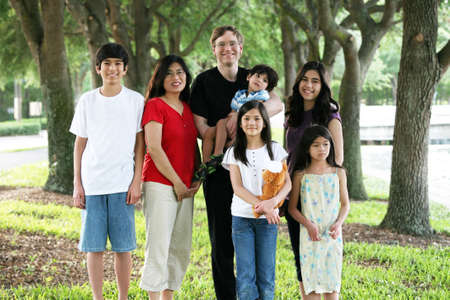Large multiracial family of seven photo