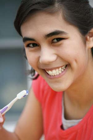 Teen brushing teeth, oral hygiene