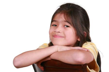 scandinavian descent: Beautiful little girl sitting on chair smiling, part Asian - Scandinavian descent