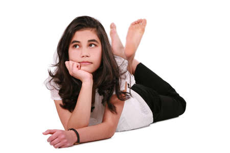 thinking woman: Beautiful teen girl lying on floor relaxing, part Asian- Caucasian background
