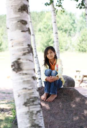 scandinavian girl: beautiful little girl quietly sitting under trees