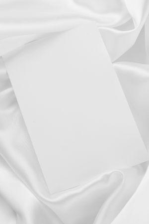 White card on elegant white satin cloth Banco de Imagens