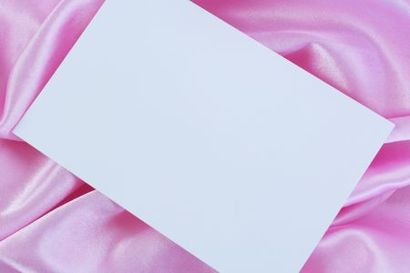 sateen: Blank white card on pink satin cloth