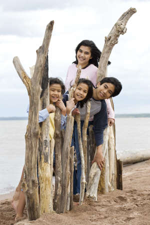 Four siblings by the lakeshore in summer photo