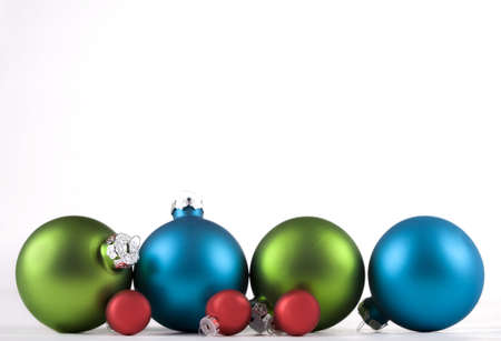 lined up: Blue and green, and red, Christmas ornaments lined up, isolated