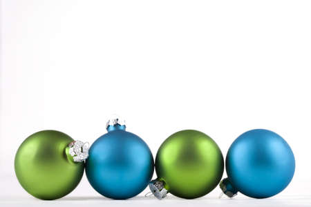 lined up: Blue and green Christmas ornaments lined up, isolated