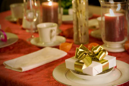 Elegant Christmas table setting in red and gold colord photo