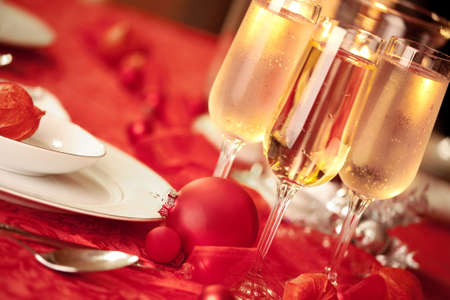 focal point: Elegant Christmas table setting in red with a Christmas ornament  as focal point